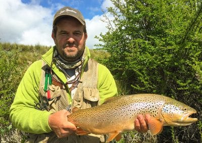 Diego holding a trout in Quillen, Patagonia